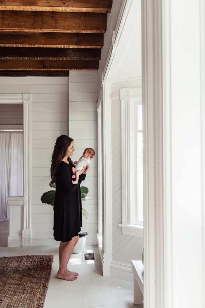 Family pictures in shiplap farmhouse